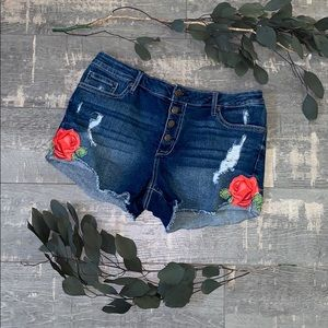 Vintage style distressed denim shorts